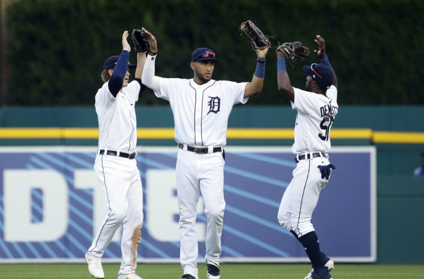 DETROIT, MI - SEPTEMBER 16: Victor Reyes #22 of the Detroit Tigers celebrates with Brandon Dixon #12, left, and Travis Demeritte #50 after a 5-2 win over the Baltimore Orioles at Comerica Park on September 16, 2019 in Detroit, Michigan. (Photo by Duane Burleson/Getty Images)