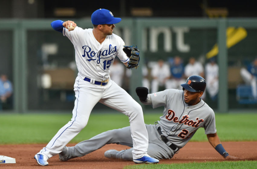 KANSAS CITY, MISSOURI - SEPTEMBER 04: Second baseman Whit Merrifield #15 of the Kansas City Royals throws past Victor Reyes #22 of the Detroit Tigers to first to complete a double play in the first inning at Kauffman Stadium on September 04, 2019 in Kansas City, Missouri. (Photo by Ed Zurga/Getty Images)