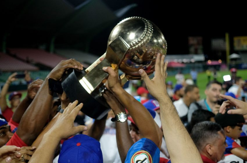 Dominican Republic's players celebrate with the championship trophy after defeating Venezuela during the Caribbean Series baseball tournament championship game at the Hiram Bithorn stadium in San Juan, Puerto Rico on February 7, 2020. (Photo by Ricardo ARDUENGO / AFP) (Photo by RICARDO ARDUENGO/AFP via Getty Images)