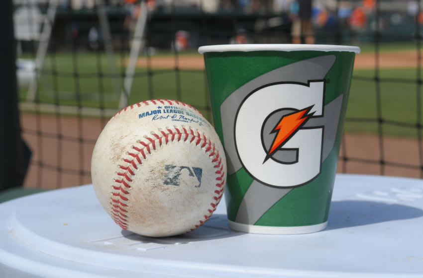 LAKELAND, FL - FEBRUARY 24: A detailed view of a Rawlings official baseball and a Gatorade cup sitting in the dugout prior to the Spring Training game between the Houston Astros and the Detroit Tigers at Publix Field at Joker Marchant Stadium on February 24, 2020 in Lakeland, Florida. The Astros defeated the Tigers 11-1. (Photo by Mark Cunningham/MLB Photos via Getty Images)
