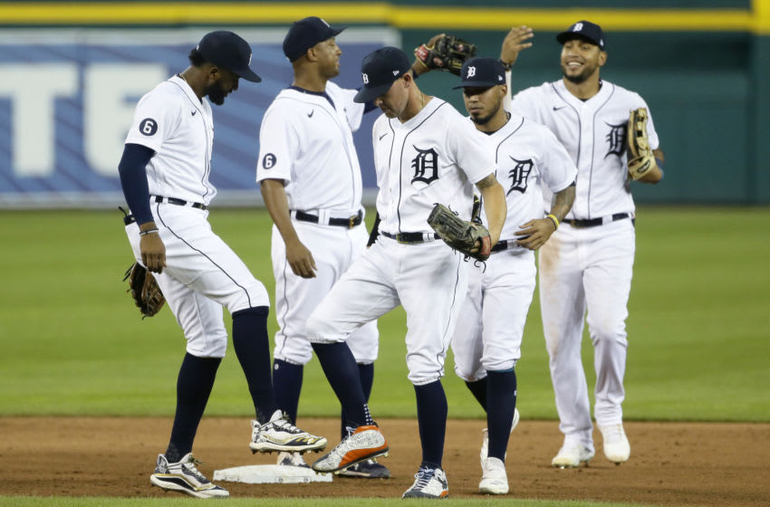 DETROIT, MI - JULY 29: Niko Goodrum #28 of the Detroit Tigers celebrates with a foot tap with JaCoby Jones #21 of the Detroit Tigers after a 5-4 win over the Kansas City Royals at Comerica Park on July 29, 2020, in Detroit, Michigan. (Photo by Duane Burleson/Getty Images)