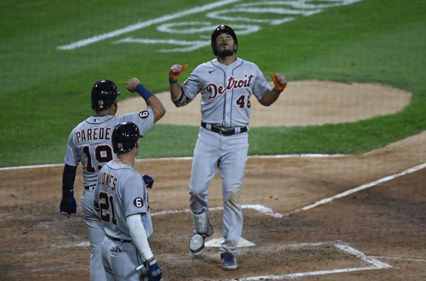 CHICAGO, ILLINOIS - AUGUST 19: Jeimer Candelario #46 of the Detroit Tigers celebrates with Isaac Paredes #19 and JaCoby Jones #21 of the Detroit Tigers after his three-run home run in the fifth inning against the Chicago White Sox at Guaranteed Rate Field on August 19, 2020 in Chicago, Illinois. (Photo by Quinn Harris/Getty Images)