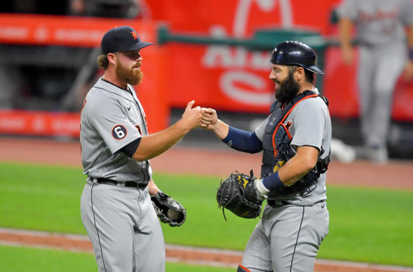 CLEVELAND, OHIO - AUGUST 21: Closing pitcher Buck Farmer #45 celebrates with catcher Austin Romine #7 of the Detroit Tigers after the Tigers defeated the Cleveland Indians at Progressive Field on August 21, 2020 in Cleveland, Ohio. The Tigers defeated the Indians 10-5. (Photo by Jason Miller/Getty Images)
