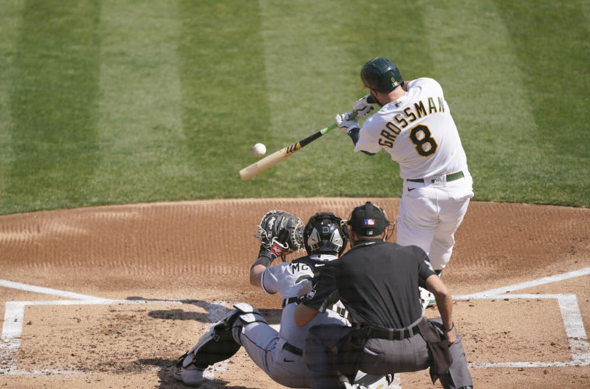 OAKLAND, CALIFORNIA - SEPTEMBER 29: Robbie Grossman #8 of the Oakland Athletics bats against the Chicago White Sox during the first inning of the Wild Card Round Game One at RingCentral Coliseum on September 29, 2020 in Oakland, California. (Photo by Thearon W. Henderson/Getty Images)