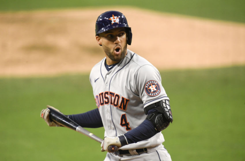 SAN DIEGO, CALIFORNIA - OCTOBER 11: George Springer #4 of the Houston Astros reacts after striking out against the Tampa Bay Rays during the fifth inning in game one of the American League Championship Series at PETCO Park on October 11, 2020 in San Diego, California. (Photo by Harry How/Getty Images)
