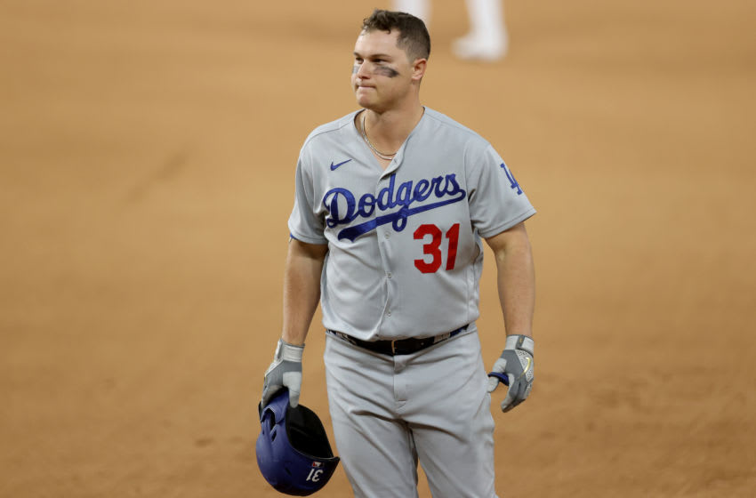 ARLINGTON, TEXAS - OCTOBER 15: Joc Pederson #31 of the Los Angeles Dodgers reacts after flying out against the Atlanta Braves during the fourth inning in Game Four of the National League Championship Series at Globe Life Field on October 15, 2020 in Arlington, Texas. (Photo by Tom Pennington/Getty Images)