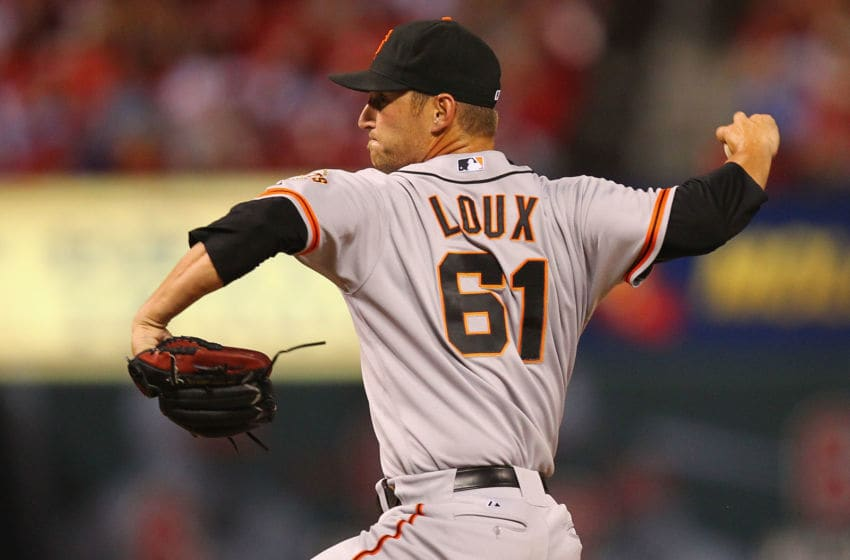 ST. LOUIS, MO - AUGUST 6: Reliever Shane Loux #61 of the San Francisco Giants pitches against the St. Louis Cardinals at Busch Stadium on August 6, 2012 in St. Louis, Missouri. (Photo by Dilip Vishwanat/Getty Images)