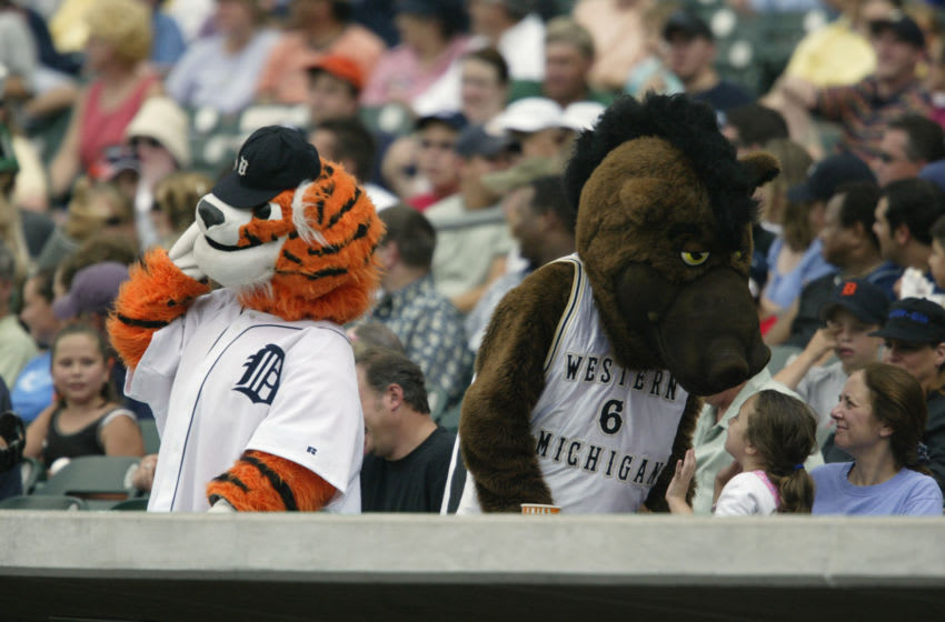 DETROIT, MI - JULY 27: Detroit Tigers mascot, Paws, and the Western Michigan University mascot, Buster Bronco, attend the MLB game between the Tigers and the Kansas City Royals at Comerica Park on July 27, 2003 in Detroit, Michigan. The Royals defeated the Tigers 5-1. (Photo by Tom Pidgeon/Getty Images)