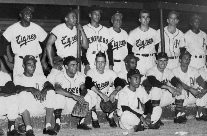 HAVANA - MARCH, 1958. The finest players in the Cuban winter league pose together at their annual All Star game in Havana in March of 1959. Camilo Pasquel is seated third from right, Tony Taylor is standing second from right, Hector Rodriguez is seated fifth from left and Minnine Minoso is seated far left. (Photo by Mark Rucker/Transcendental Graphics, Getty Images)