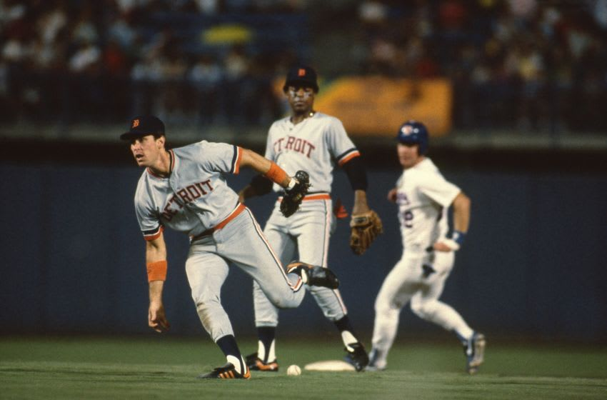 ARLINGTON, TX - 1986: Shortstop Alan Trammell #3 can not make the play at teammate Lou Whitaker #1 looks on during a game against the Texas Rangers circa 1986 at Arlington Stadium in Arlington, Texas. (Photo by Louis DeLuca/MLB via Getty Images)