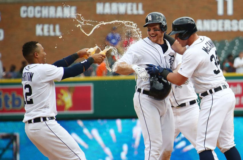 DETROIT, MI - MAY 02: John Hicks #55 of the Detroit Tigers celebrates his game winning RBI bunt in the 12th inning to beat the Tampa Bay Rays 3-2 with Leonys Martin #12 and James McCann #34 at Comerica Park on May 2, 2018 in Detroit, Michigan. (Photo by Gregory Shamus/Getty Images)