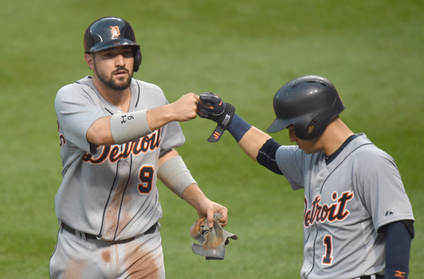 BALTIMORE, MD - JULY 30: Nick Castellanos #9 celebrates scoring a run with Jose Iglesias #1 of the Detroit Tigers on a Rajai Davis #20 (not pictured) triple in the fourth inning during a baseball game against the Baltimore Orioles at Oriole Park at Camden Yards on July 30, 2015 in Baltimore, Maryland. (Photo by Mitchell Layton/Getty Images)