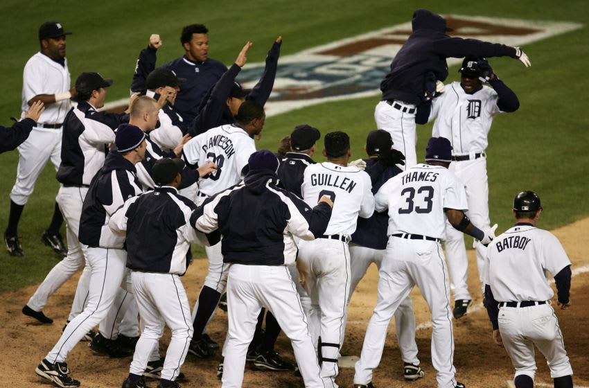 DETROIT - OCTOBER 14: Players from the Detroit Tigers celebrate at home plate as Craig Monroe runs home on a 3-run walk-off home run, hit by Magglio Ordonez, against the Oakland Athletics during Game Four of the American League Championship Series October 14, 2006 at Comerica Park in Detroit, Michigan. The Tigers won 6-3 to sweep the Athletics and advance to the World Series. (Photo by Jonathan Daniel/Getty Images)