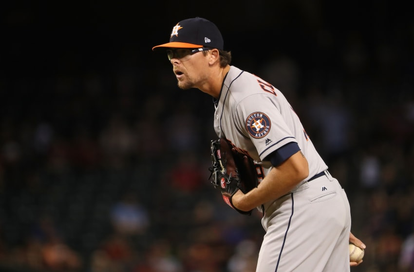PHOENIX, AZ - AUGUST 14: Relief pitcher Tyler Clippard #19 of the Houston Astros pitches against the Arizona Diamondbacks during the eighth inning of the MLB game at Chase Field on August 14, 2017 in Phoenix, Arizona. The Diamondbacks defeated the Astros 2-0. (Photo by Christian Petersen/Getty Images)