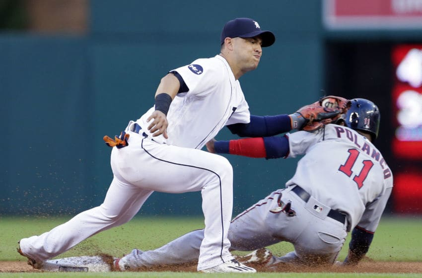 DETROIT, MI - AUGUST 11: Shortstop Jose Iglesias #1 of the Detroit Tigers tags out Jorge Polanco #11 of the Minnesota Twins trying to steal second base during the third inning at Comerica Park on August 11, 2017 in Detroit, Michigan. (Photo by Duane Burleson/Getty Images)