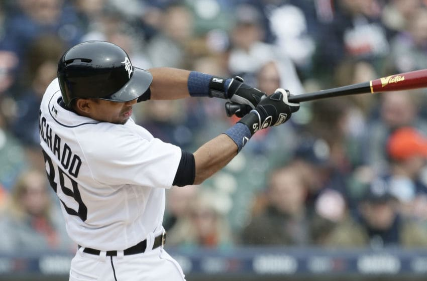 DETROIT, MI - APRIL 21: Dixon Machado #49 of the Detroit Tigers hits an RBI-single to drive in Victor Martinez of the Detroit Tigers during the fifth inning of a game against the Kansas City Royals at Comerica Park on April 21, 2018 in Detroit, Michigan. The Tigers defeated the Royals 12-4. (Photo by Duane Burleson/Getty Images)