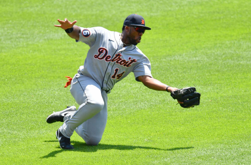 CINCINNATI, OH - JULY 26: Christian Stewart #14 of the Detroit Tigers makes a sliding catch of a short fly ball in left field in the first inning against the Cincinnati Reds at Great American Ball Park on July 26, 2020 in Cincinnati, Ohio. (Photo by Jamie Sabau/Getty Images)