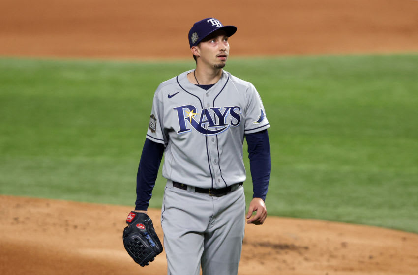 ARLINGTON, TEXAS - OCTOBER 21: Blake Snell #4 of the Tampa Bay Rays returns to the dugout after retiring the side against the Los Angeles Dodgers during the first inning in Game Two of the 2020 MLB World Series at Globe Life Field on October 21, 2020 in Arlington, Texas. (Photo by Sean M. Haffey/Getty Images)