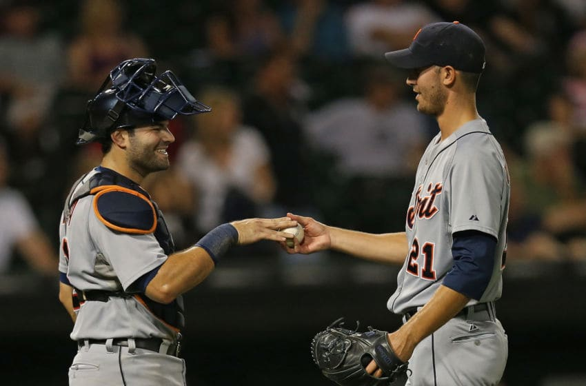 CHICAGO, IL - SEPTEMBER 10: Alex Avila #13 of the the Detroit Tigers (L) hands the ball to Rick Porcello #21 after Porcello's complete game win over the Chicago White Sox at U.S. Cellular Field on September 10, 2013 in Chicago, Illinois. The Tigers defeated the White Sox 9-1. (Photo by Jonathan Daniel/Getty Images)