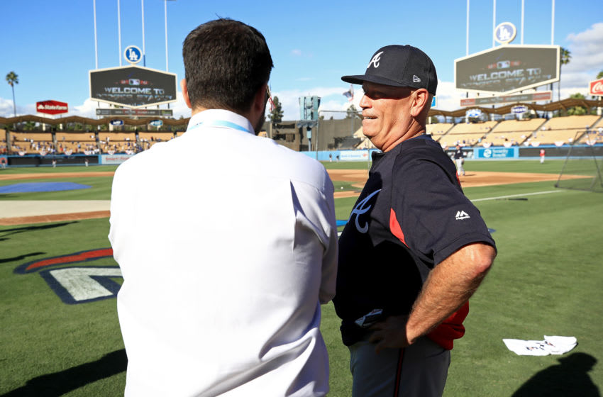 LOS ANGELES, CA - OCTOBER 04: General manager Alex Anthopoulos and manager Brian Snitker #43 of the Atlanta Braves talk during batting practice prior to Game One of the National League Division Series against the Los Angeles Dodgers at Dodger Stadium on October 4, 2018 in Los Angeles, California. (Photo by Sean M. Haffey/Getty Images)