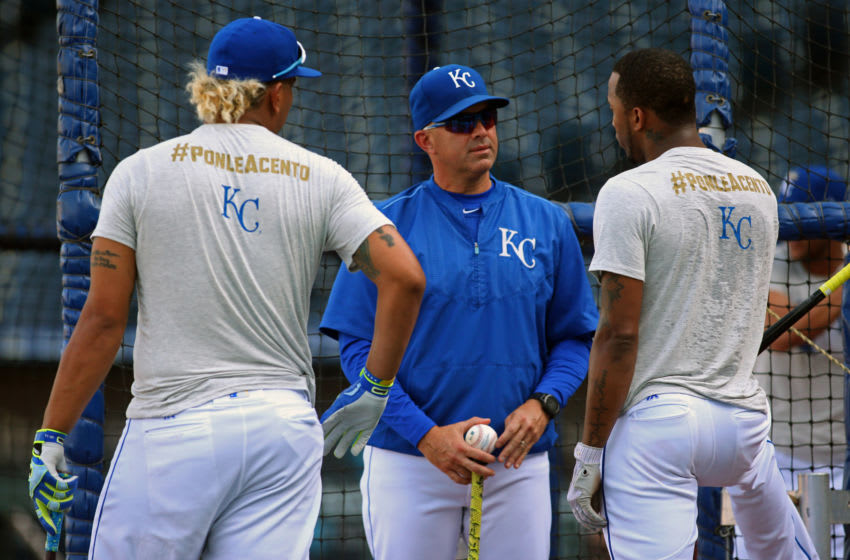 Sep 8, 2017; Kansas City, MO, USA; Kansas City Royals catcher Salvador Perez (13) and shortstop Alcides Escobar (2) talk with first base coach Pedro Grifol (28) while wearing shirts featuring the tagline Ponle Acento for Major League Baseball Hispanic Heritage Month before the game against the Minnesota Twins at Kauffman Stadium. Mandatory Credit: Jay Biggerstaff-USA TODAY Sports