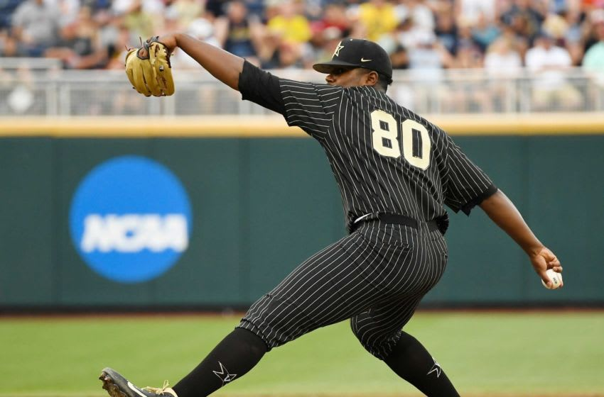 Vanderbilt pitcher Kumar Rocker throws in the bottom of the first inning against Michigan.