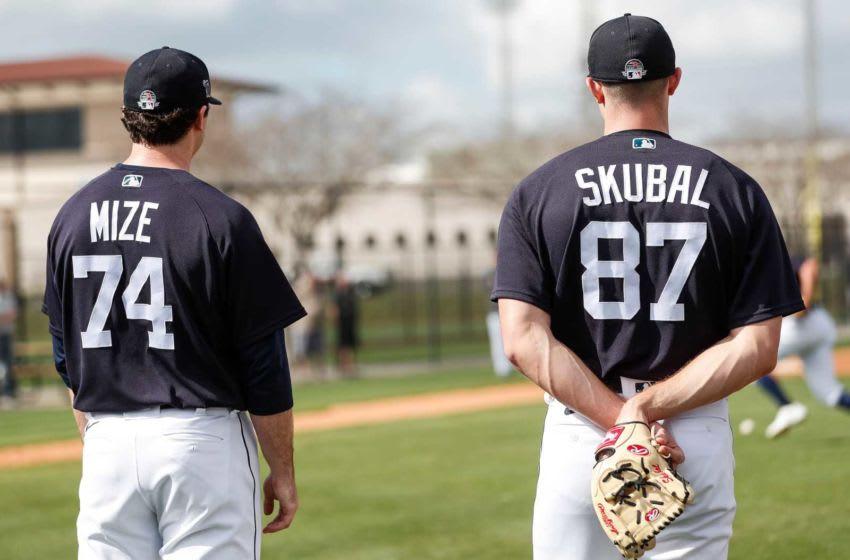 Pitchers Casey Mize and Tarik Skubal watch practice.