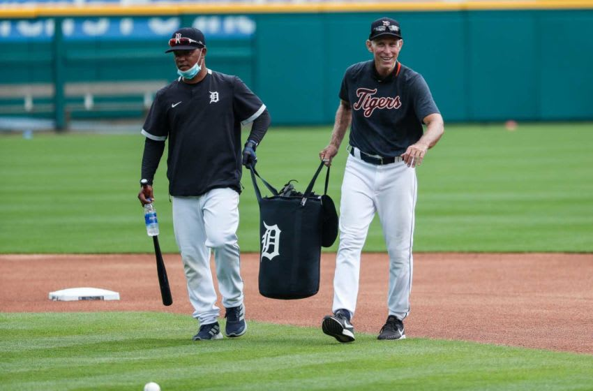 Detroit Tigers third base coach Ramon Santiago and Alan Trammell lug the ball bag to the mound during training camp at Comerica Park in Detroit, Tuesday, July 7, 2020. Detroit Tigers Ramon Santiago Alan Trammell