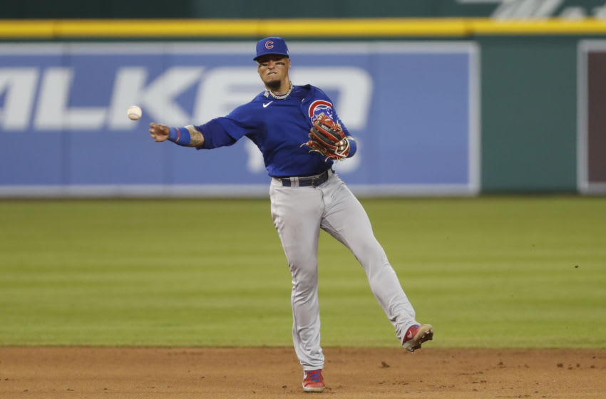 Aug 24, 2020; Detroit, Michigan, USA; Chicago Cubs shortstop Javier Baez (9) makes a throw to first base for an out during the sixth inning against the Detroit Tigers at Comerica Park. Mandatory Credit: Raj Mehta-USA TODAY Sports