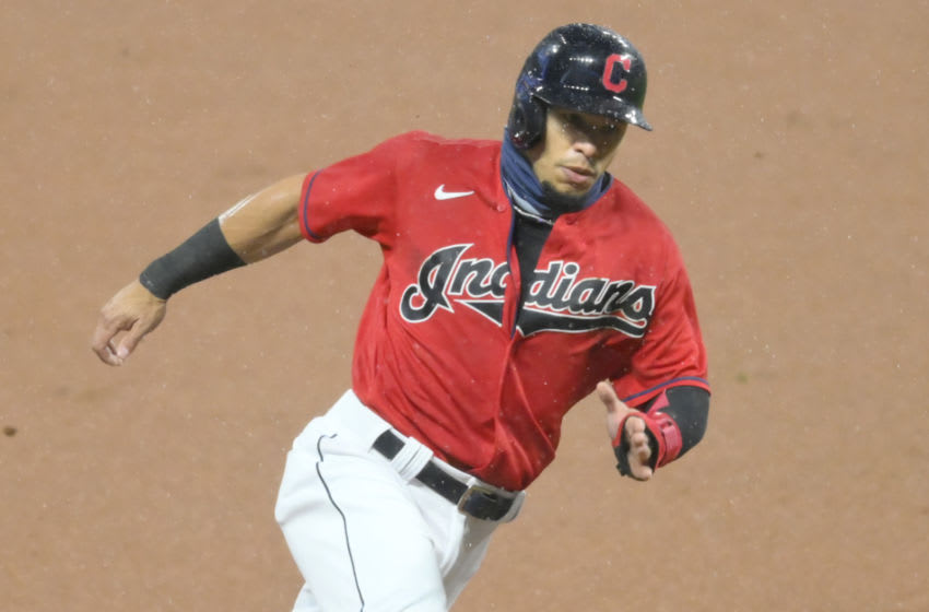 Sep 30, 2020; Cleveland, Ohio, USA; Cleveland Indians second baseman Cesar Hernandez (7) rounds third base while scoring in the first inning against the New York Yankees at Progressive Field. Mandatory Credit: David Richard-USA TODAY Sports