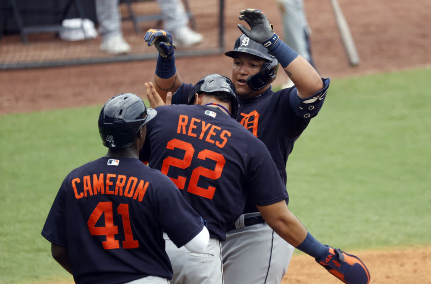 Mar 29, 2021; Tampa, Florida, USA; Detroit Tigers first baseman Miguel Cabrera (24) is congratulated by center fielder Daz Cameron (41) and center fielder Victor Reyes (22) after he hit a three-run home run during the fifth inning against the New York Yankees at George M. Steinbrenner Field. Mandatory Credit: Kim Klement-USA TODAY Sports