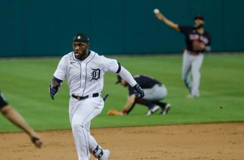 Detroit Tigers center fielder Akil Baddoo runs towards third base.