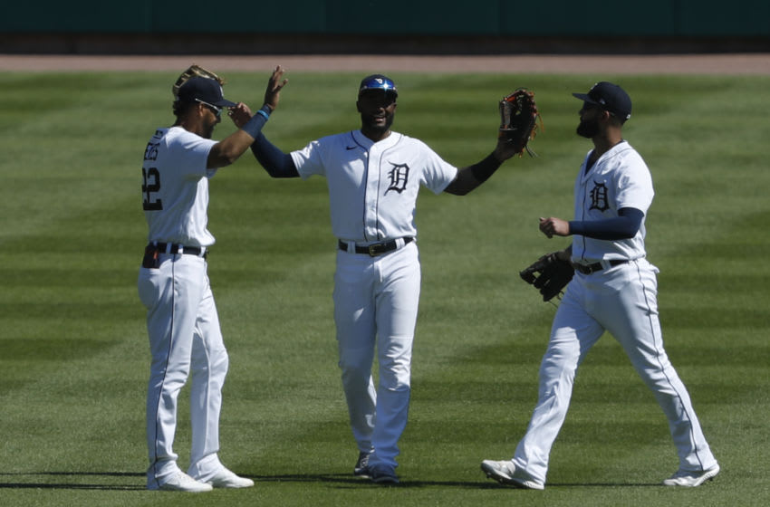 May 30, 2021; Detroit, Michigan, USA; (Left to right) Detroit Tigers left fielder Victor Reyes (22) center fielder Niko Goodrum (28) and right fielder Nomar Mazara (15) celebrate together after the game against the New York Yankees at Comerica Park. Mandatory Credit: Raj Mehta-USA TODAY Sports