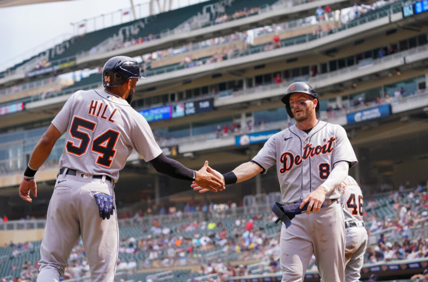 Jul 28, 2021; Minneapolis, Minnesota, USA; Detroit Tigers outfielder Robbie Grossman (8) celebrates his run with outfielder Derek Hill (54) against the Minnesota Twins in the ninth inning at Target Field. Mandatory Credit: Brad Rempel-USA TODAY Sports