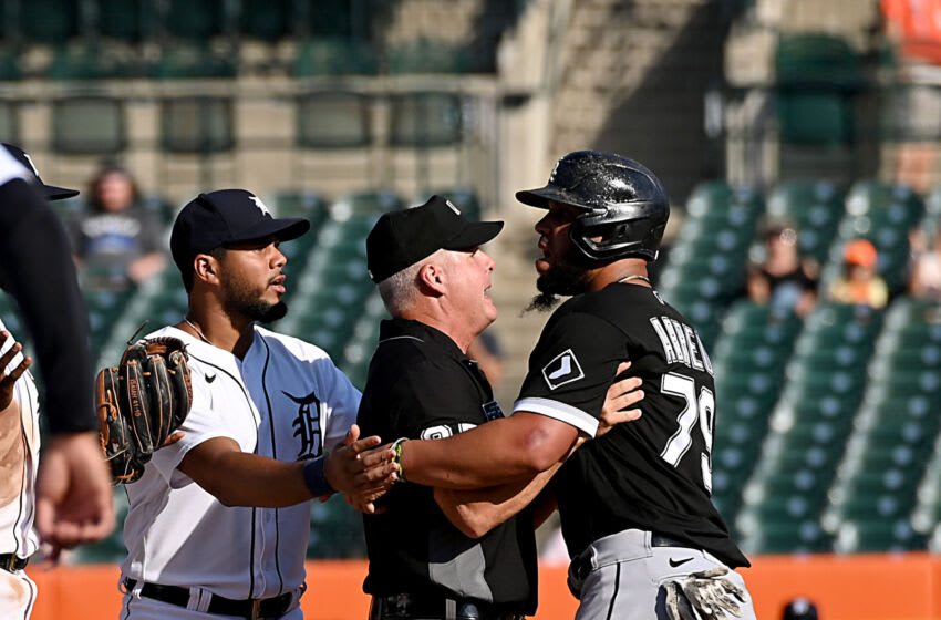 Sep 27, 2021; Detroit, Michigan, USA; Players close-in on second base after Detrot Tigers shortstop Niko Goodrum tagged Chicago White Sox baserunner Jose Abreu while stealing second base and causes a ninth-inning bench clearing brawl at Comerica Park. Mandatory Credit: Dale Young-USA TODAY Sports
