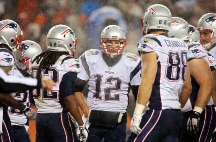 Nov 29, 2015; Denver, CO, USA; New England Patriots quarterback Tom Brady (12) talks with teammates in the huddle during the second half against the Denver Broncos at Sports Authority Field at Mile High. The Broncos won 30-24. Mandatory Credit: Chris Humphreys-USA TODAY Sports