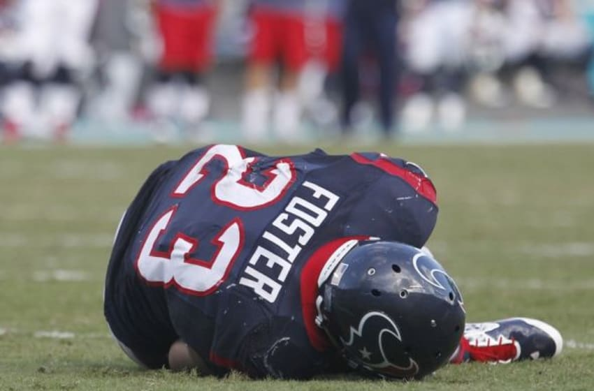 Oct 25, 2015; Miami Gardens, FL, USA; Houston Texans running back Arian Foster (23) lays on the ground after being injured in the fourth quarter against the Miami Dolphins at Sun Life Stadium. The Dolphins won 44-26. Mandatory Credit: Andrew Innerarity-USA TODAY Sports