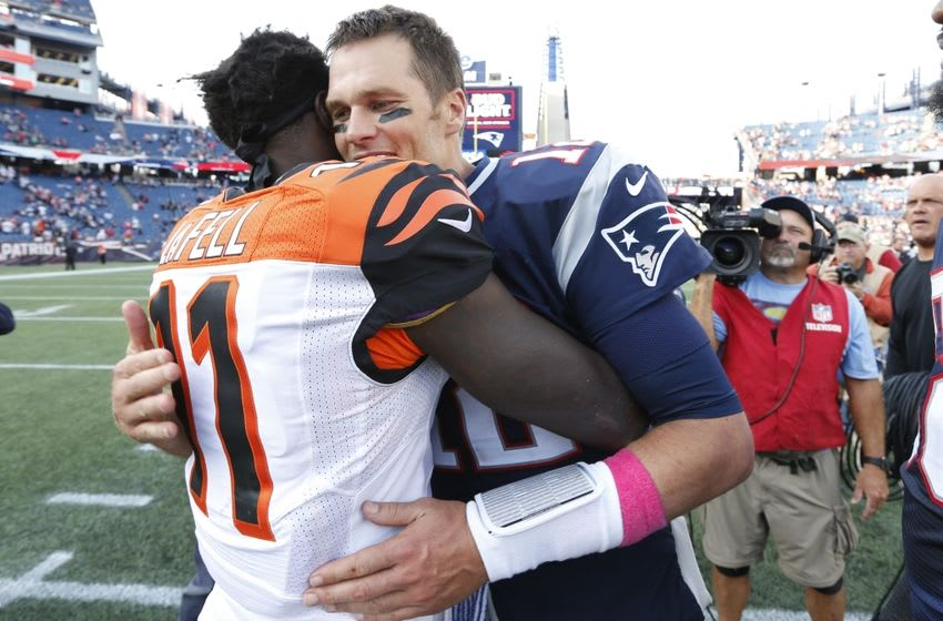 Oct 16, 2016; Foxborough, MA, USA; New England Patriots quarterback Tom Brady (12) greets Cincinnati Bengals wide receiver Brandon LaFell (11) after the game at Gillette Stadium. The New England Patriots won 35-17. Mandatory Credit: Greg M. Cooper-USA TODAY Sports