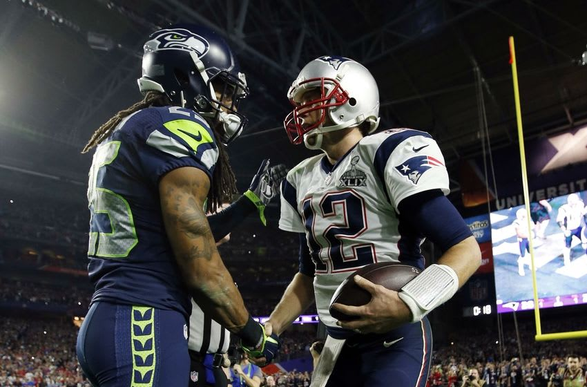 Feb 1, 2015; Glendale, AZ, USA; Seattle Seahawks cornerback Richard Sherman (left) shakes hands with New England Patriots quarterback Tom Brady (12) after Super Bowl XLIX at University of Phoenix Stadium. Mandatory Credit: Mark J. Rebilas-USA TODAY Sports