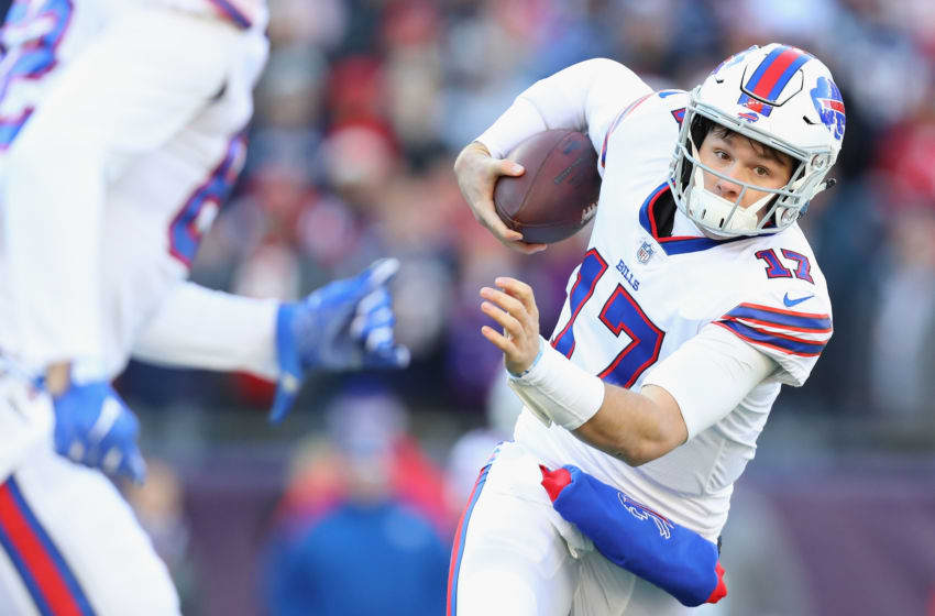 FOXBOROUGH, MA - DECEMBER 23: Josh Allen #17 of the Buffalo Bills runs with the ball during the first half against the New England Patriots at Gillette Stadium on December 23, 2018 in Foxborough, Massachusetts. (Photo by Maddie Meyer/Getty Images)