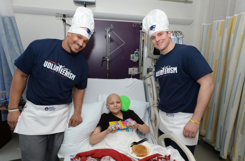 BOSTON, MA - MARCH 12: New England Patriot's Derek Rivers (L) and Ryan Izzo visit with Jacob at Boston Children's Hospital March 12, 2019 in Boston, Massachusetts. (Photo by Darren McCollester/Getty Images for Boston Children's Hospital)