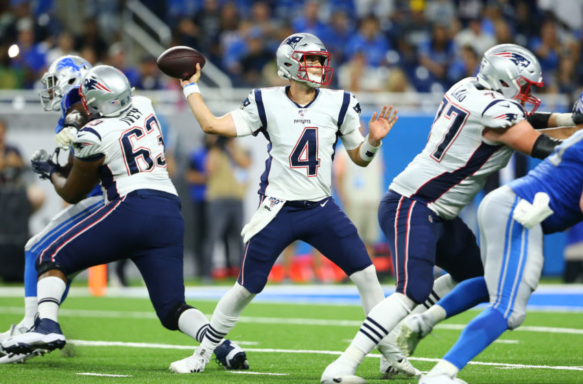 DETROIT, MI - AUGUST 08: Jarrett Stidham #4 of the New England Patriots drops back to pass during the second quarter of the game against the Detroit Lions during the preseason game at Ford Field on August 8, 2019 in Detroit, Michigan. (Photo by Rey Del Rio/Getty Images)