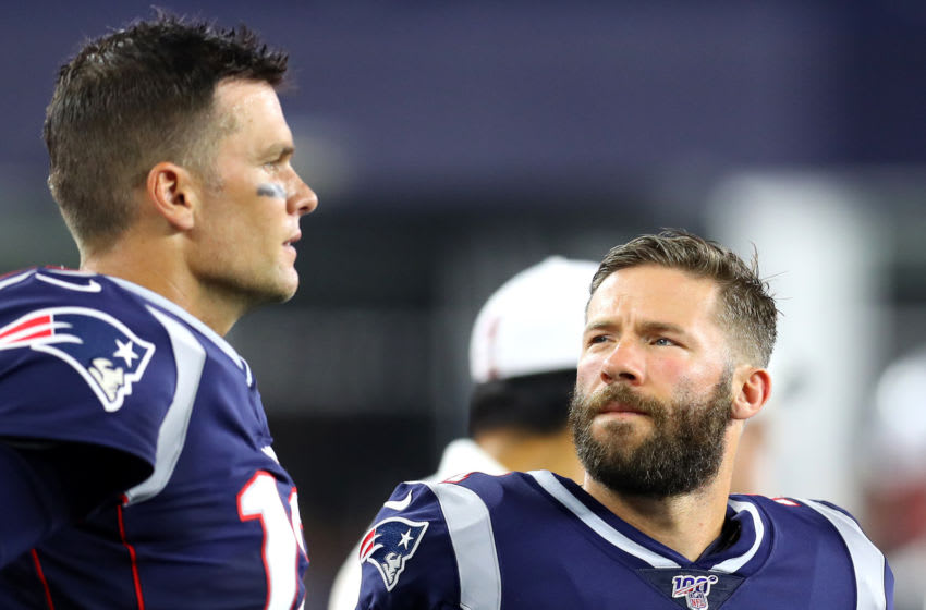 Tom Brady #12 of the New England Patriots and Julian Edelman #11 talk on the sideline (Photo by Maddie Meyer/Getty Images)
