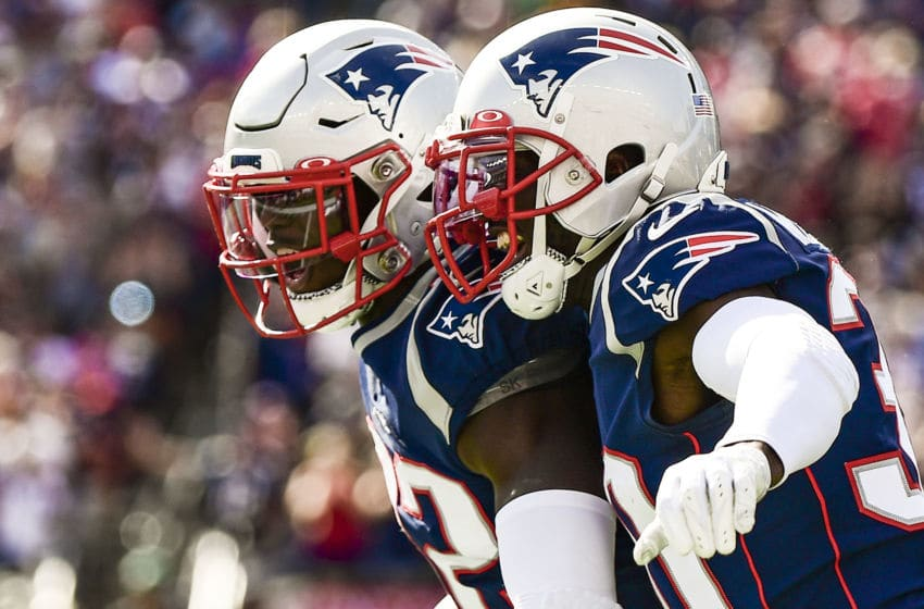 FOXBOROUGH, MA - SEPTEMBER 22: Devin McCourty #32 of the New England Patriots reacts with Jason McCourty #30 after intercepting a pass during the third quarter of a game against the New York Jets at Gillette Stadium on September 22, 2019 in Foxborough, Massachusetts. (Photo by Billie Weiss/Getty Images)