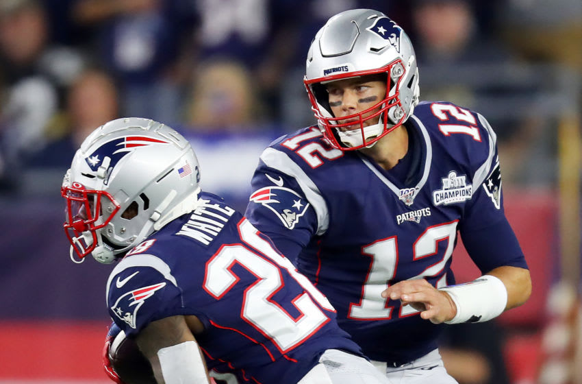 FOXBOROUGH, MASSACHUSETTS - SEPTEMBER 08: Tom Brady #12 of the New England Patriots hands the ball off to James White #28 during the game between the New England Patriots and the Pittsburgh Steelers at Gillette Stadium on September 08, 2019 in Foxborough, Massachusetts. (Photo by Maddie Meyer/Getty Images)