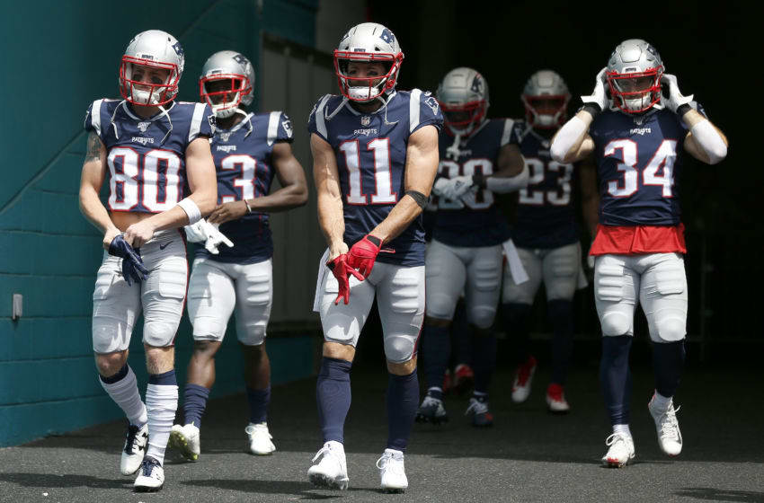 MIAMI, FLORIDA - SEPTEMBER 15: Gunner Olszewski #80, Julian Edelman #11 and Rex Burkhead #34 of the New England Patriots take the field prior to the game against the Miami Dolphins at Hard Rock Stadium on September 15, 2019 in Miami, Florida. (Photo by Michael Reaves/Getty Images)