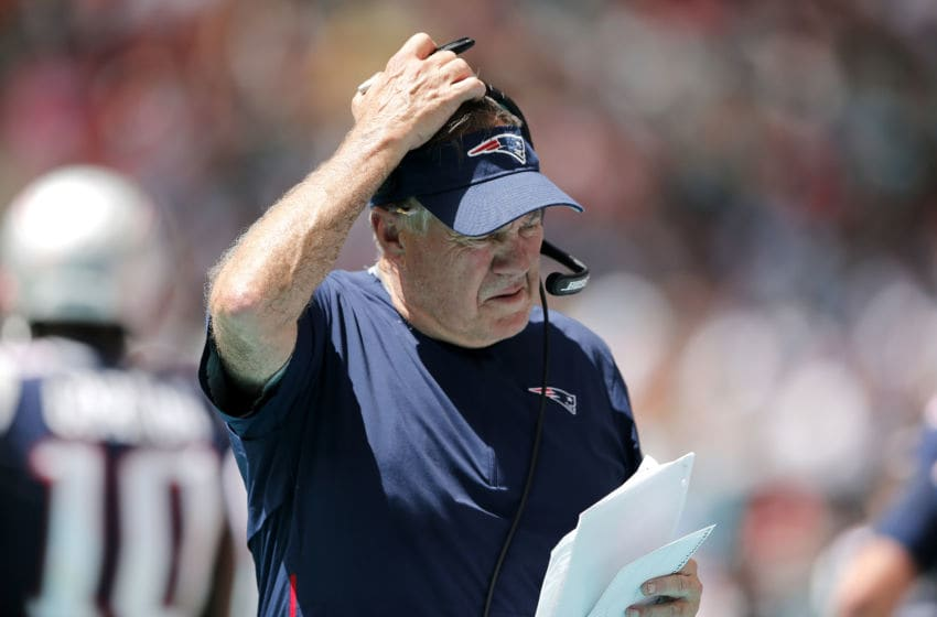 MIAMI, FLORIDA - SEPTEMBER 15: Head coach Bill Belichick of the New England Patriots looks on against the Miami Dolphins during the first half in the game at Hard Rock Stadium on September 15, 2019 in Miami, Florida. (Photo by Michael Reaves/Getty Images)