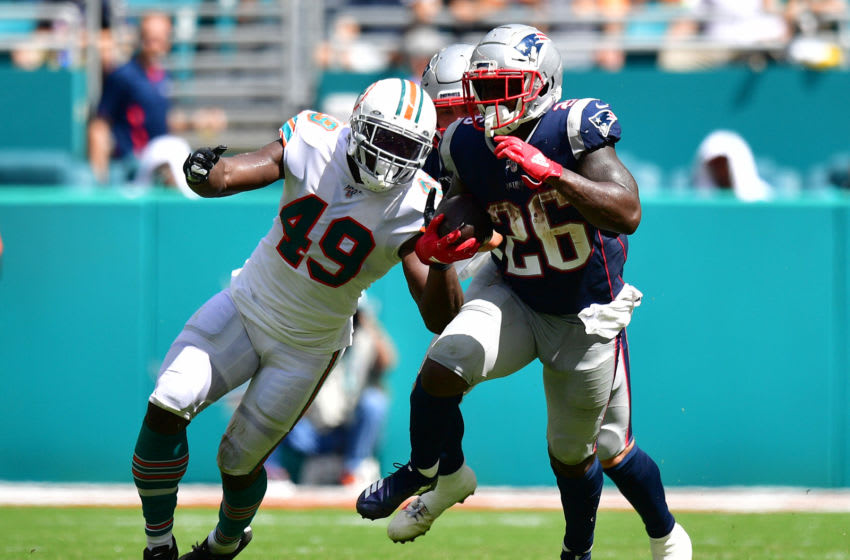 MIAMI, FLORIDA - SEPTEMBER 15: Sony Michel #26 of the New England Patriots runs with the ball in the third quarter against the Miami Dolphins at Hard Rock Stadium on September 15, 2019 in Miami, Florida. (Photo by Mark Brown/Getty Images)