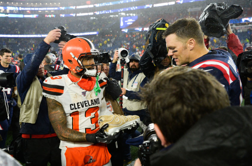 FOXBOROUGH, MA - OCTOBER 27: Odell Beckham Jr. #13 of the Cleveland Browns gifts his cleats to Tom Brady #12 of the New England Patriots following the game at Gillette Stadium on October 27, 2019 in Foxborough, Massachusetts. (Photo by Kathryn Riley/Getty Images)