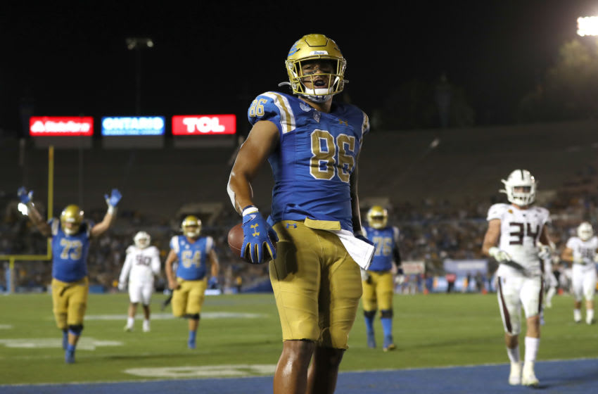 LOS ANGELES, CALIFORNIA - OCTOBER 26: Devin Asiasi #86 of the UCLA Bruins reacts after scoring a touchdown during the second half of a game against the Arizona State Sun Devils on October 26, 2019 in Los Angeles, California. (Photo by Sean M. Haffey/Getty Images)